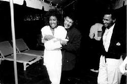 Left to right: Singer Whitney Houston, producer Narada Michael Walden, and Walden's brother at Houston's party
