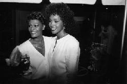 Singer Dionne Warwick and Whitney Houston at Whitney's 26th birthday bash.